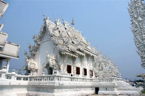 The Creepily Peculiar White Temple of Chiang Rai - Man On